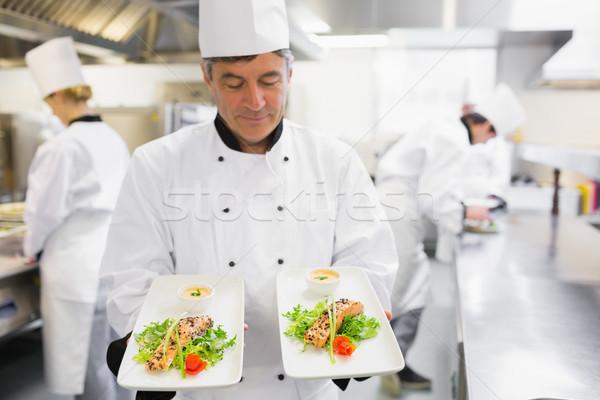 Chef due salmone piatti mani cucina Foto d'archivio © wavebreak_media