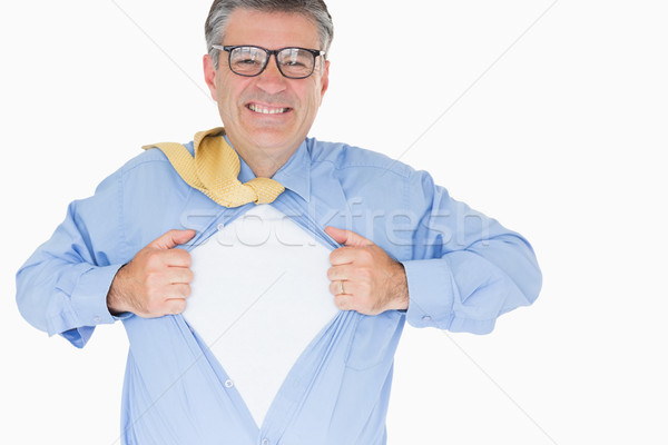 Man with glasses is pulling his shirt with his hands like a superhero Stock photo © wavebreak_media