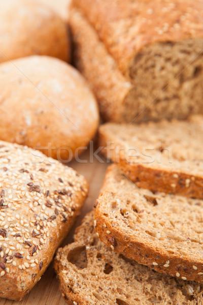 Wholemeal bread lying on the wooden background  Stock photo © wavebreak_media