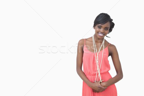 Kadın ayakta pembe elbise inciler Stok fotoğraf © wavebreak_media