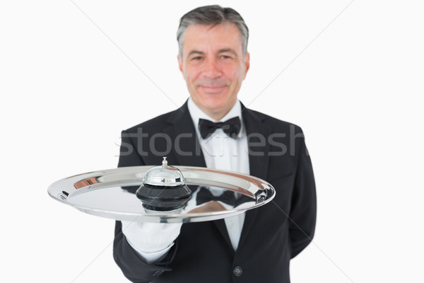 Smiling man holding a hotel bell on a silver tray Stock photo © wavebreak_media