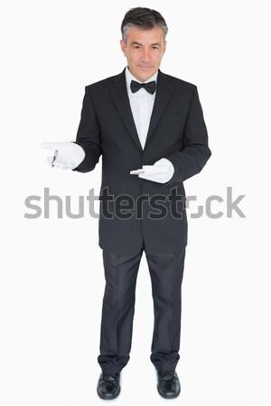 Happy waiter standing in uniform Stock photo © wavebreak_media