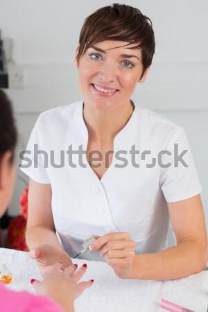 Maid using whisk as microphone Stock photo © wavebreak_media