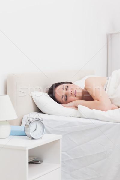 Beautiful woman sleeping in bed Stock photo © wavebreak_media