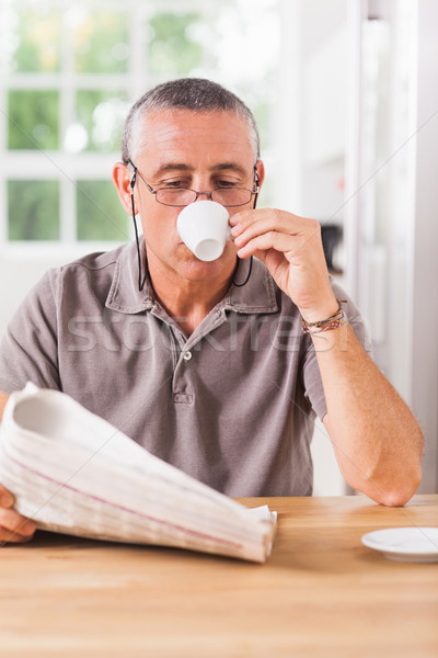 Man reading newspaper and drinking espresso Stock photo © wavebreak_media