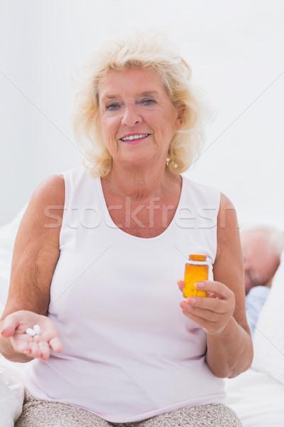 Kadın hap şişe Stok fotoğraf © wavebreak_media