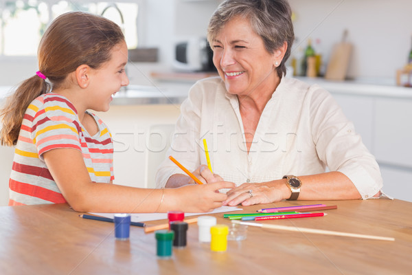 Gyermek nagyi rajz nevet konyha papír Stock fotó © wavebreak_media