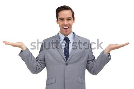 Sonriendo empresario algo manos blanco Foto stock © wavebreak_media