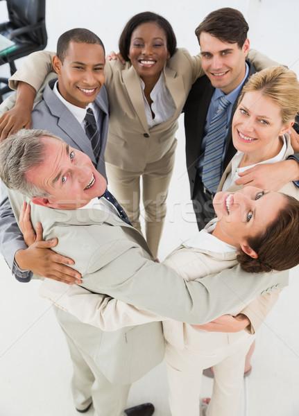 Różnorodny zespół firmy kółko uśmiechnięty kamery Zdjęcia stock © wavebreak_media
