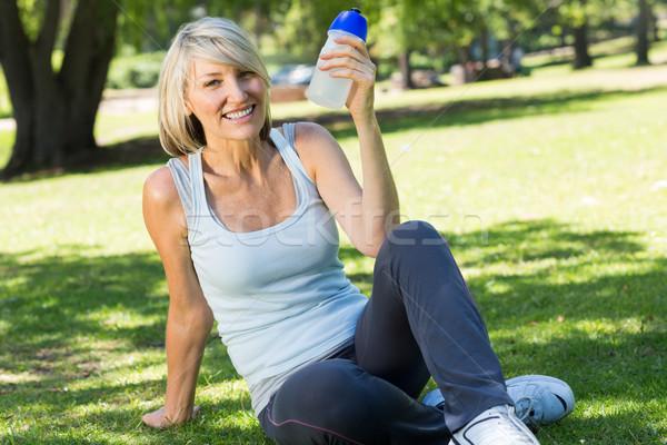 Relaxed woman holding water bottle in park Stock photo © wavebreak_media