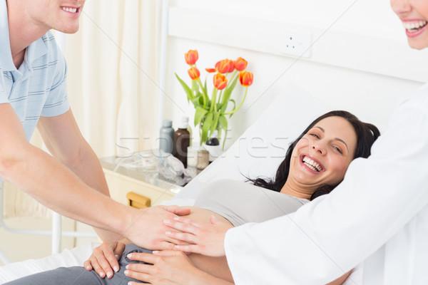 Heureux femme enceinte homme médecin portrait hôpital Photo stock © wavebreak_media
