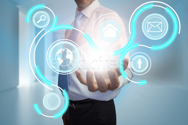 Businessman presenting interface with email and earth options Stock photo © wavebreak_media