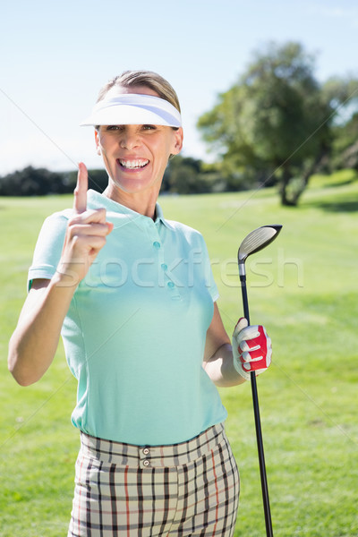 Female golfer standing and pointing up Stock photo © wavebreak_media