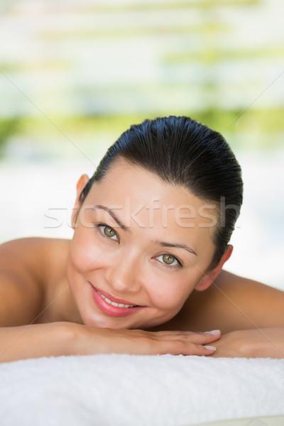 Sorridere bruna massaggio tavola spa hotel Foto d'archivio © wavebreak_media