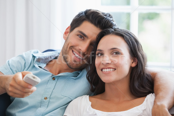 Attractive couple watching tv on the couch Stock photo © wavebreak_media