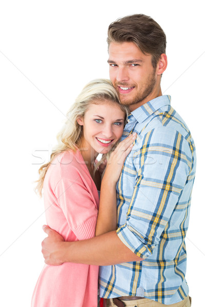 Attractive couple embracing and smiling at camera Stock photo © wavebreak_media