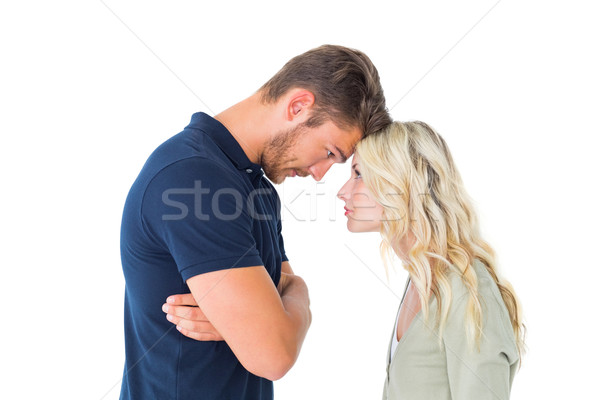 Young couple standing head to head Stock photo © wavebreak_media