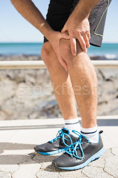 S'adapter homme préhension blessés genou Photo stock © wavebreak_media