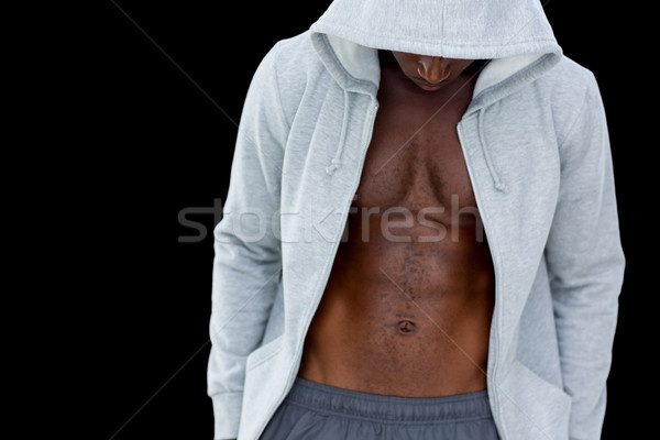 Muscular young man in hood jacket Stock photo © wavebreak_media