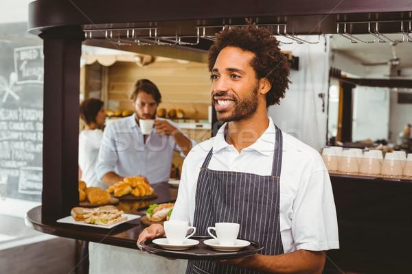 Przystojny kelner uśmiechnięty taca kawiarnia Zdjęcia stock © wavebreak_media