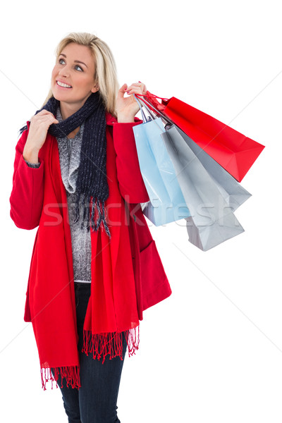 Blonde in winter clothes holding shopping bags Stock photo © wavebreak_media