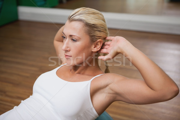 Woman doing abdominal crunches on fitness ball in gym Stock photo © wavebreak_media