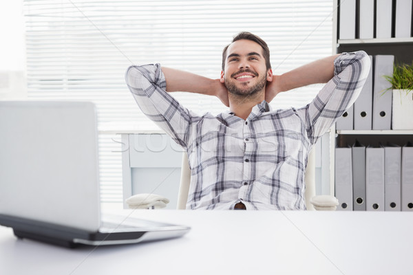 Lezser üzletember megnyugtató asztal hátradőlő iroda Stock fotó © wavebreak_media