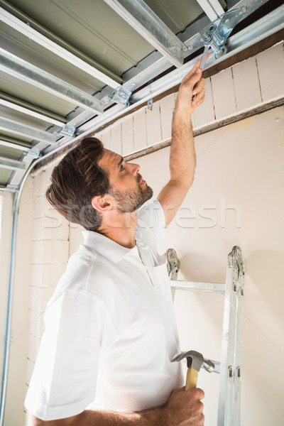 Construction worker fixing the ceiling Stock photo © wavebreak_media