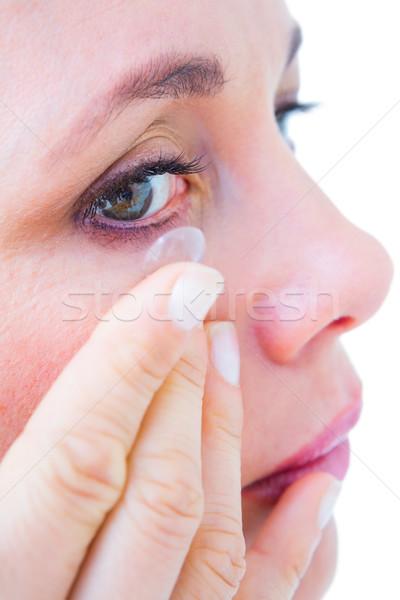 женщину контактная линза белый зеленый Сток-фото © wavebreak_media