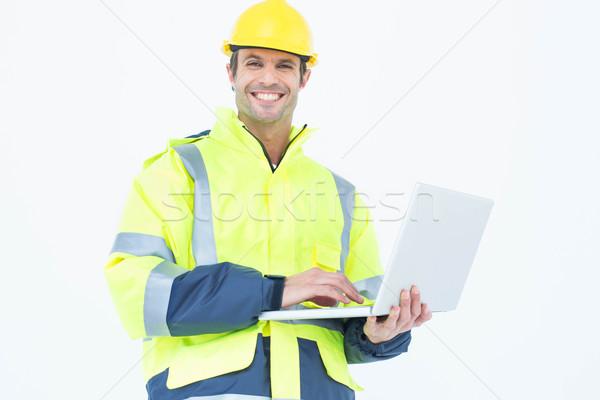 Male architect in reflective clothing using laptop Stock photo © wavebreak_media