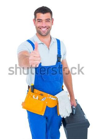 Happy carpenter in overalls with hands on hip Stock photo © wavebreak_media