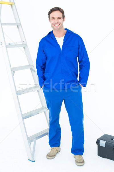Carpenter in overalls standing with hands in pockets Stock photo © wavebreak_media