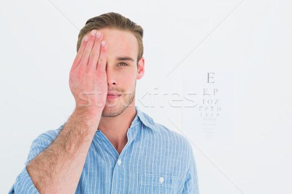 Paciente olhando câmera um olho branco Foto stock © wavebreak_media