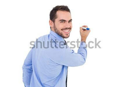 Happy young male mechanic using mobile phone Stock photo © wavebreak_media