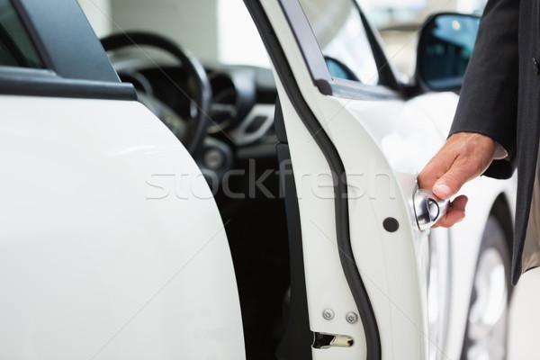 Férfi nyitás autó ajtó új autó bemutatóterem Stock fotó © wavebreak_media