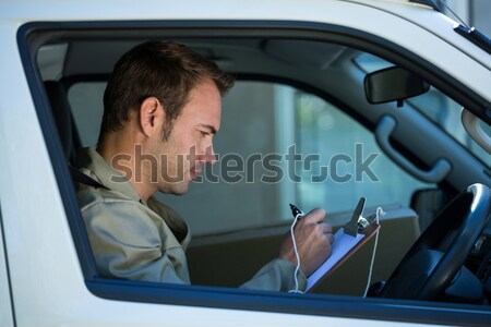 Learner driver smiling and holding l plate Stock photo © wavebreak_media