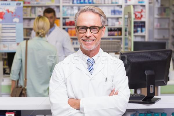 Sorridente farmacêutico olhando câmera hospital farmácia Foto stock © wavebreak_media