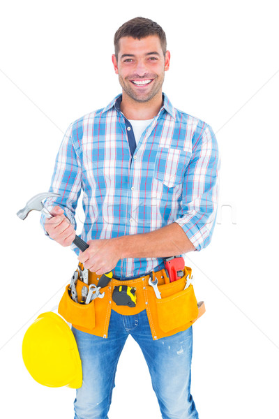 Portrait of confident repairman holding hammer Stock photo © wavebreak_media