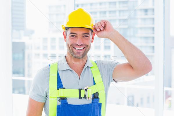 Happy manual worker wearing yellow hard hat Stock photo © wavebreak_media