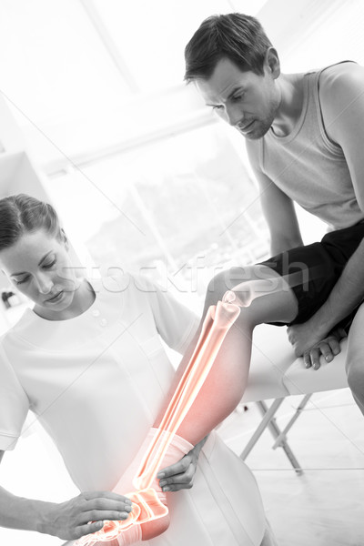 Highlighted knee of injured man at physiotherapist  Stock photo © wavebreak_media
