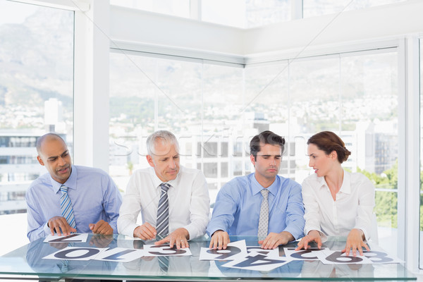 Concentrated business team sitting with their vote on the desk Stock photo © wavebreak_media