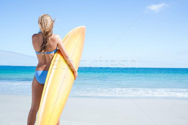Joli femme blonde surf bord plage Photo stock © wavebreak_media