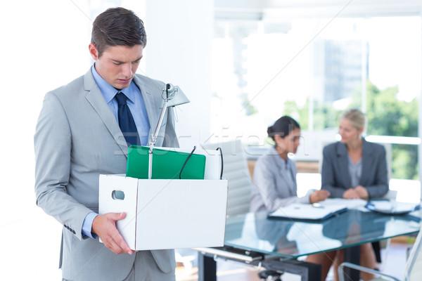 Businessman carrying his belongings in box Stock photo © wavebreak_media