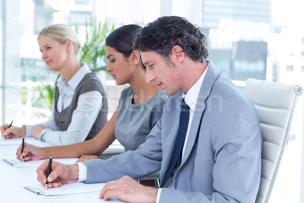 Gruppo uomini d'affari prendere appunti ufficio donna corporate Foto d'archivio © wavebreak_media