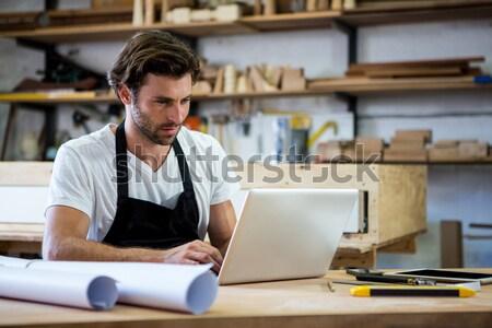 Warehouse manager using laptop Stock photo © wavebreak_media