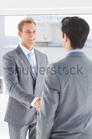 Businessman shaking co workers hand Stock photo © wavebreak_media