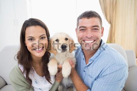Happy couple with their pet dog Stock photo © wavebreak_media