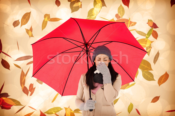 Composite image of sick brunette blowing her nose while holding  Stock photo © wavebreak_media