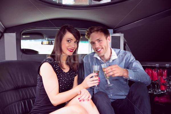 Happy friends drinking champagne in limousine Stock photo © wavebreak_media