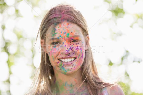 Pretty blonde covered in powder paint Stock photo © wavebreak_media